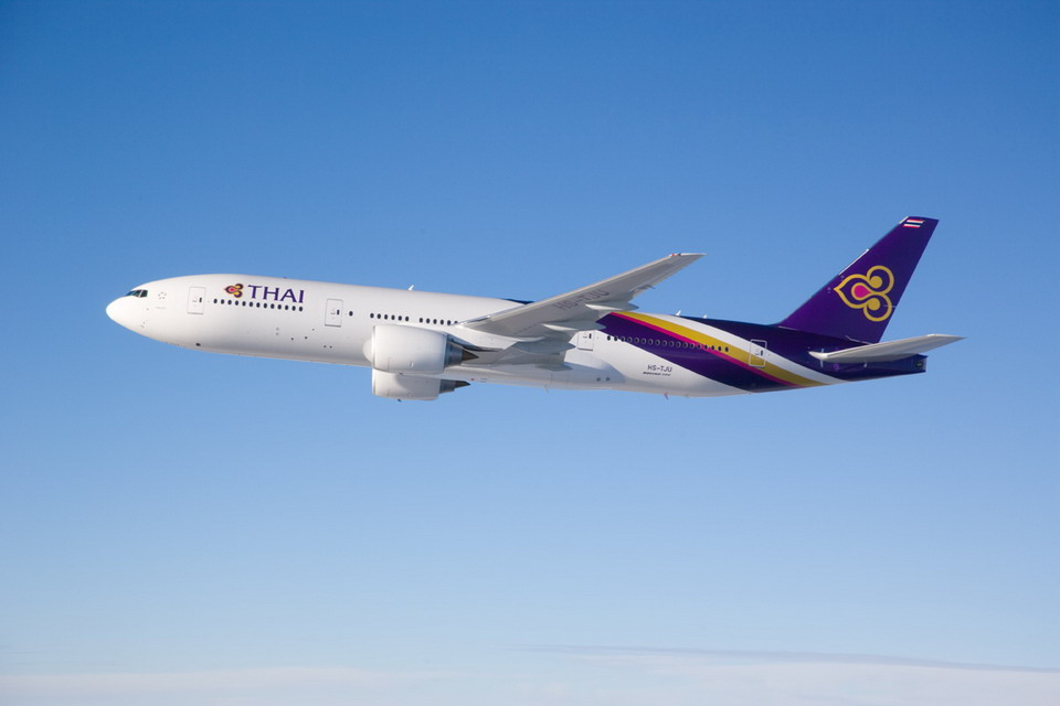 "Boeing 777-2D7ER ""Phichit"" flown by Thai Airways International photographed from Clay Lacy Aviation Astrovision-equipped Learjet on November 30, 2006."